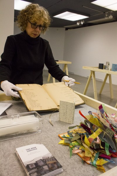 Taking inventory of the handmade books, which are to be displayed in an upcoming exhibit.