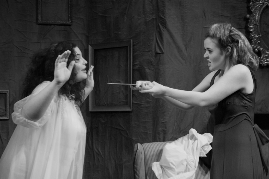 Estelle, played by Trestine Henderson, threatens Ines, played by Chloie Torblaa, character with a letter opener.