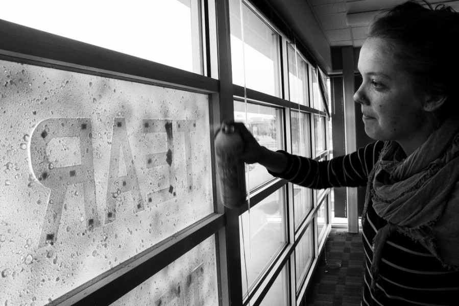 Arianna Sullivan performs a few touch-ups to the Snow Poem.