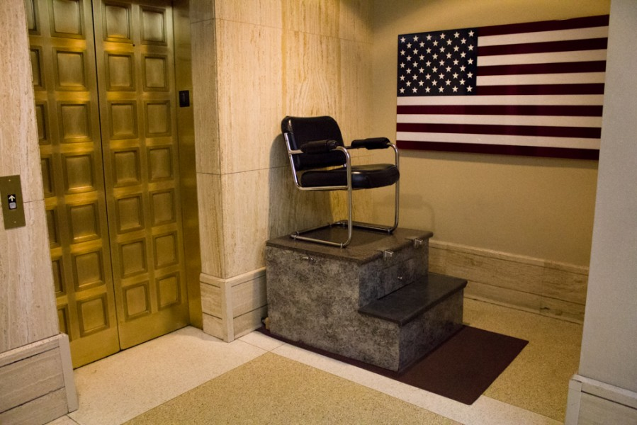 Gold doors, shoe shines, and American flags.