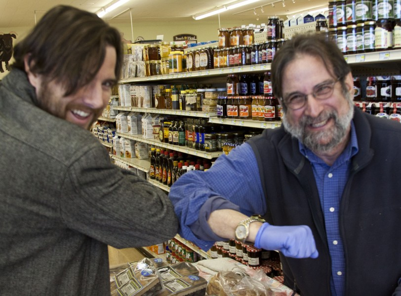 Dennis revealing the official handshake of all the big shot movers and shakers.