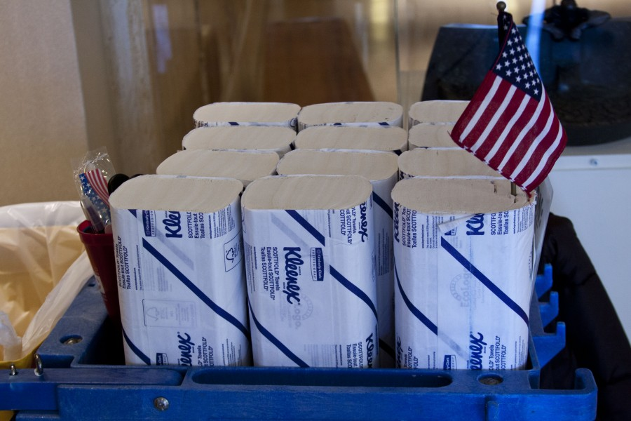 Patriotic tissue papers rests on a janitor's cart.