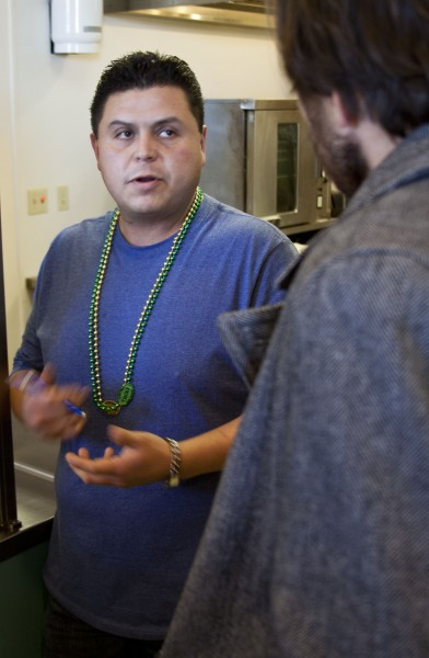 The cafe manager, Joe Mora, explaining how he and his hard working culinary crew are making food from 5 in the morning til 3 inthe afternoon.