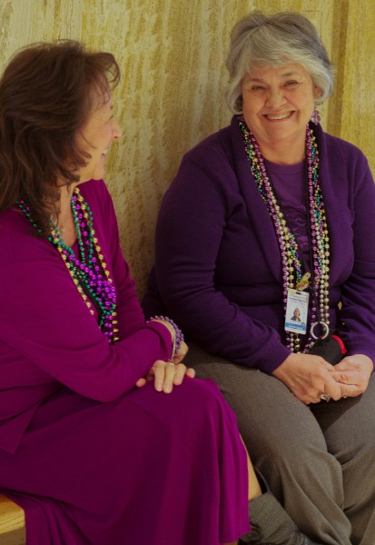Two tour guides share a laugh while they await their next guests.