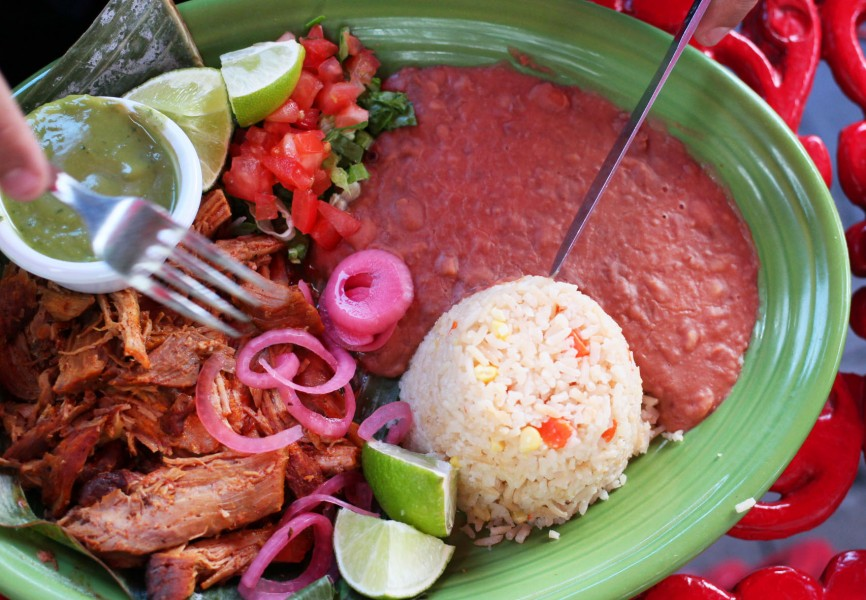 """Cochinita Pibil"" is a dish that originated in the Yucatán. It consists of pork marinated in a citric juice that's cooked inside a  banana leaf. This is eaten in special occasions, as it is hard to prepare."