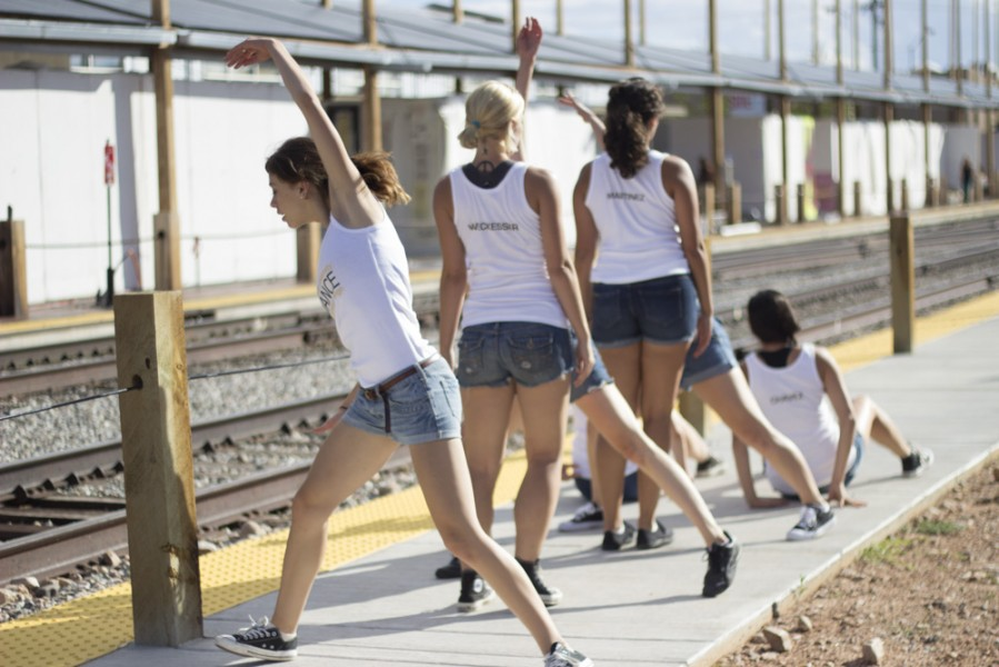 Incorporating both sides of the railyard, the dancers move along the sidewalk behind the booths of the festival. Photo by Amanda Tyler