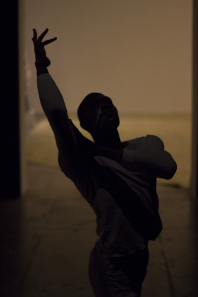 One Arcos dancer moves through a hallway, after he worked his way through the audience. Photo by Amanda Tyler