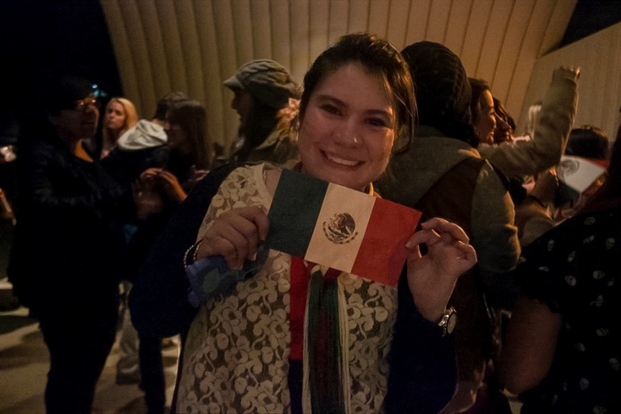 "Maho Balbas proudly displays the mexican flag while celebrating ""el grito"" on the Quad."