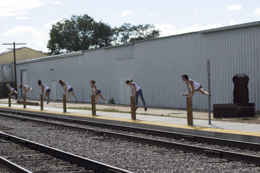 Shannon Elliott choreographed the site specific piece to incorporate the fence posts on the side of the railroad track. Photo by Amanda Tyler
