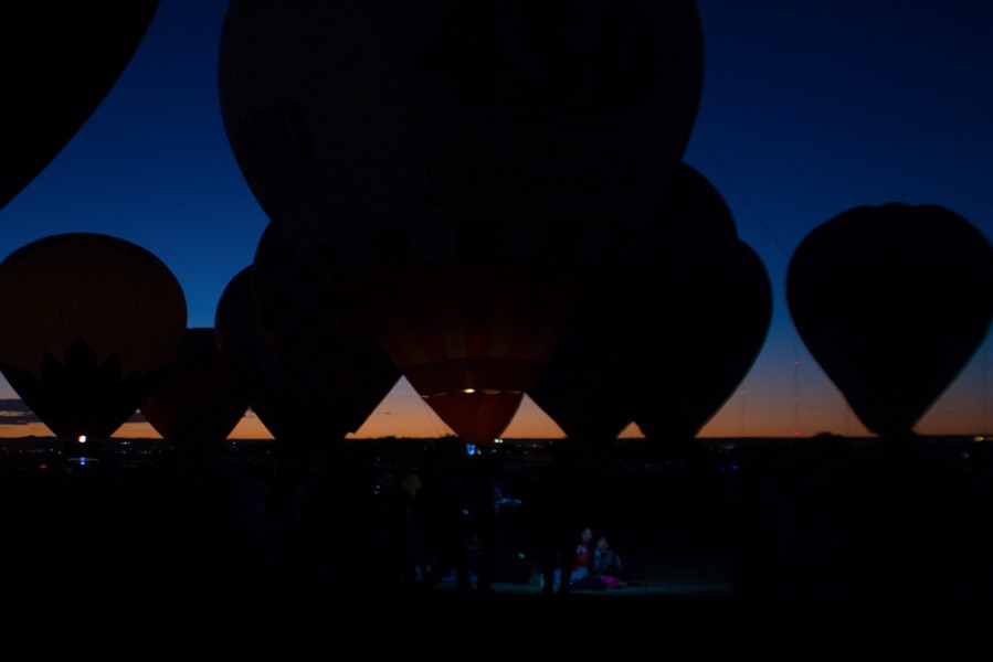 Silhouettes of the balloons stand against the Albuquerque sunset. Photo by Amanda Tyler.