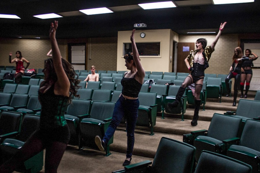 Members of the cast dance through the aisles of The Forum, the group's temporary rehearsal space.