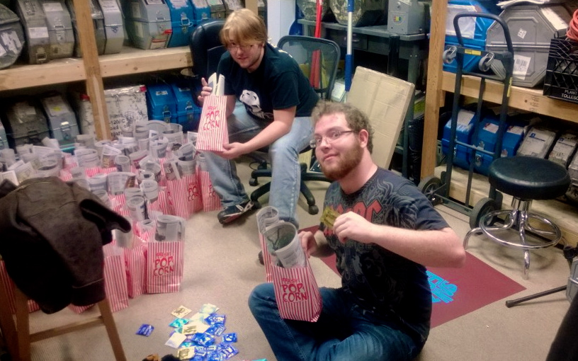 "Peter Crowder and Jack Brinkley fill the ""goody bags"" for the Rocky Horror Picture Show. Photo by Charlotte Martinez"
