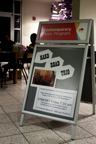 A Hard Road Trio poster sits outside the performance space.
