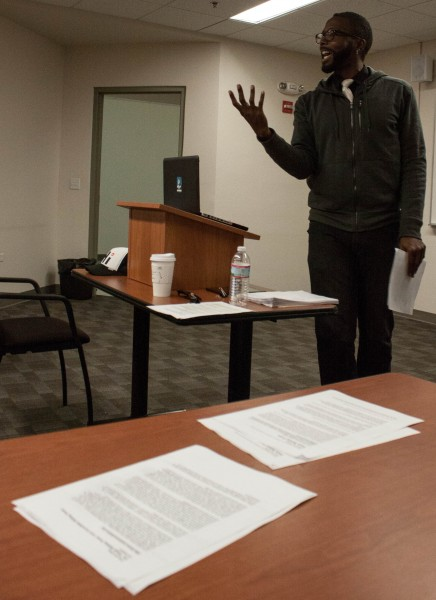 Bellamy discusses the overlap between nonfiction and poetry during a workshop held for students. Photo by Tim Kassiotis