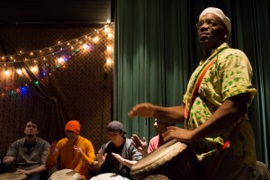 Fred Simpson, Director of the African Drum Ensemble, leads the students.