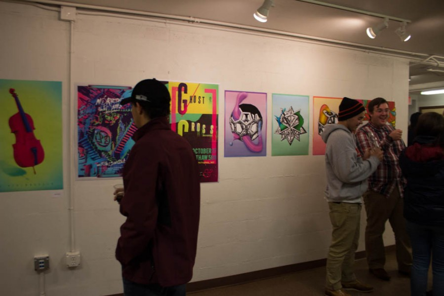 Students view some of the work in the show.