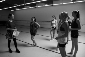The dance students work with Elliott.