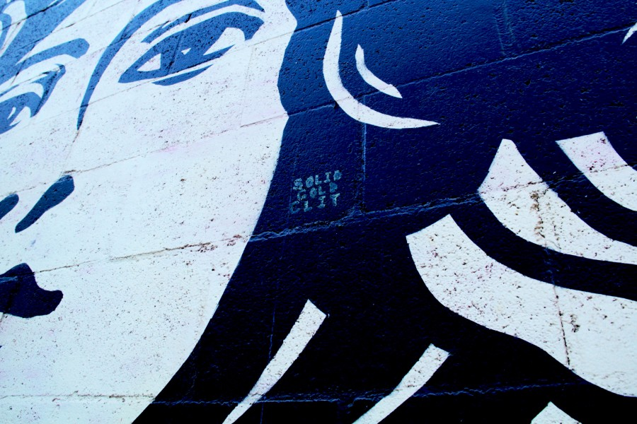 The Shepard Fairey Mural on campus got a taste of SGC. Photo by Rose Abella