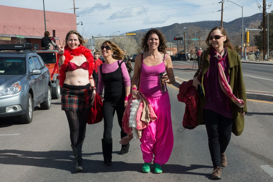 Women make their way from the capital to a park downtown for a group meditation. Photo by Luke Montavon