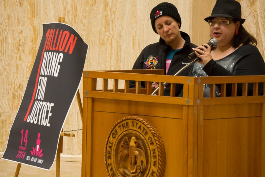 Faculty Corrine Frankland (left) supports student Sherylyn Jeffries (right) while she gave testimony in the capital Friday as part of the 1 Billion Rising Campaign. Photo by Luke Montavon
