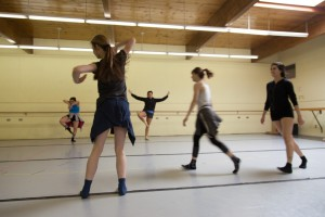 The dancers rehearse Gilbert's piece.