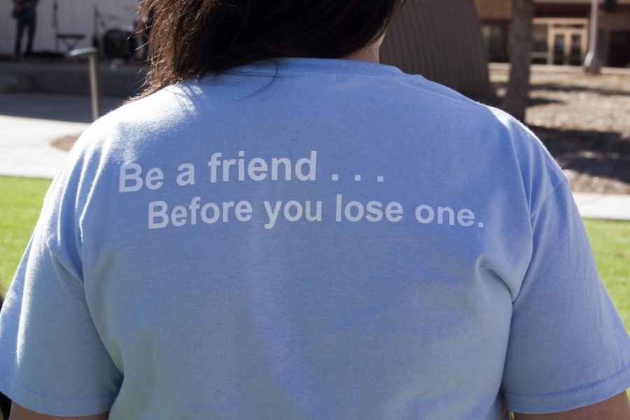 Chelsea Garcia shows the back of the suicide awareness shirts