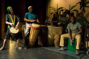 Contemporary Music major J.D. Soliz and Fred Simpson, rehearse with other members of the African Drum ensemble and the Spirit of Uganda company in preparation for last Saturday's concert. Photo by Luke Montavon