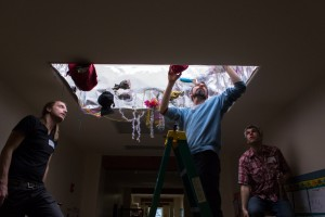 Zevin Polzin, Nick Chiarella, and Chirstopher Johnson install the light-based structures.