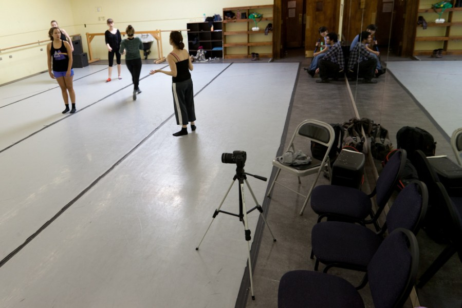 Jocelyne Danchick works with the dancers while film students set up equipment.
