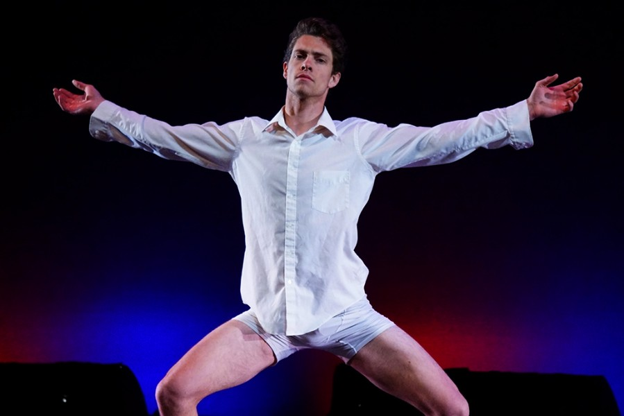 "Guest dancer, Paolo Speirn, as a ""Model Citizen"" in the Rise Above spring 2014 dance concert. Photo by Luke Montavon"