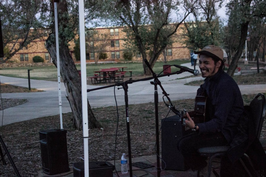 Joel Ortega gets up to perform on the side stage and share the music he's been writing.