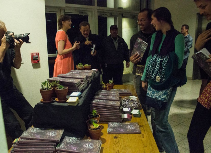 Everyone at the event excitedly lines up to grab his or her copy of Glyph, with photographers present and delightful catering at the end of the reading.
