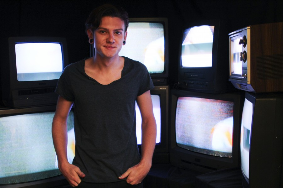 C. Alex Clark with the tube televisions used in his thesis