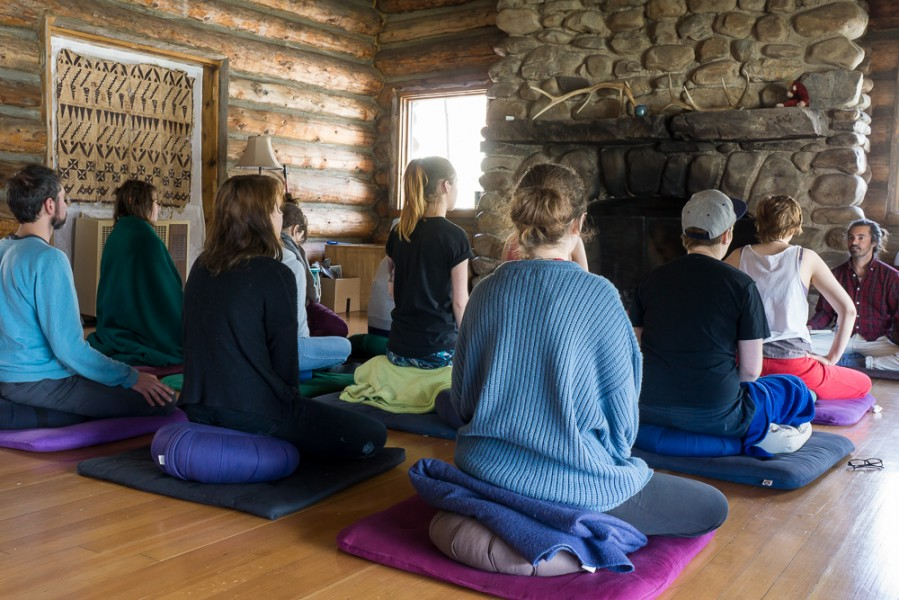 Students of the Artful Awareness course get comfortable for meditation practice. Photo by Luke Montavon