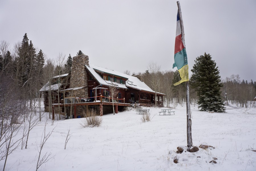 An exterior view of the El Vallecito Ranch snowy cabin. Photo by Luke Montavon