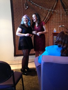 Katie Johnson and Sara Malinowski laughing in nerves prior to their senior reading.