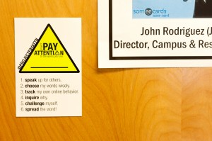 The main initiatives for Project Pay Attention are outlined on the door of John Rodriguez, the director of Campus and Residential Life.