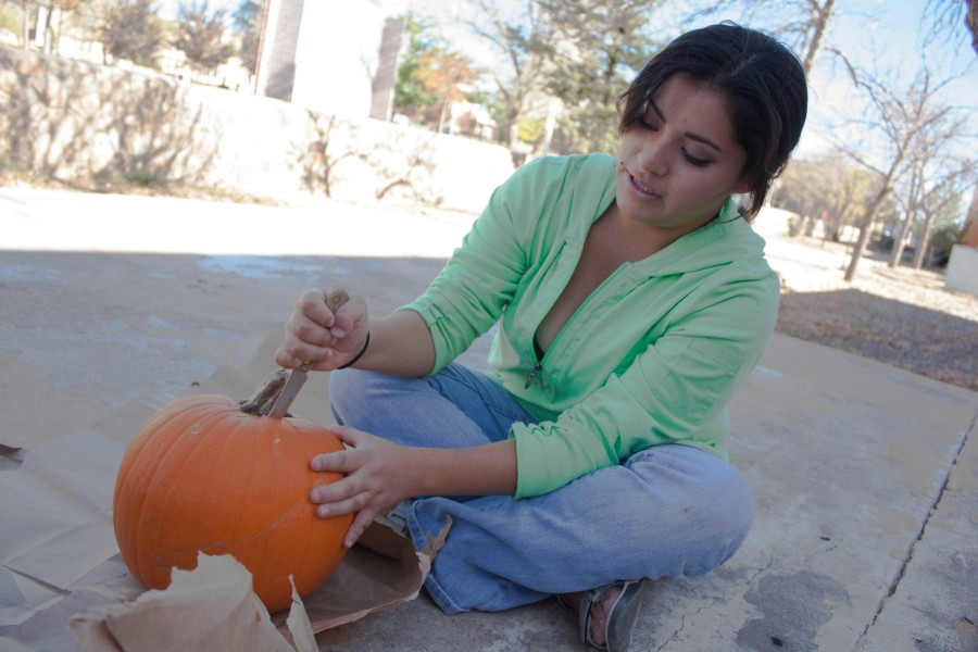 Nancy Ayala, photography student, carving a pumpkin. photo by Humberto Loeza