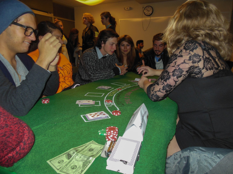 The blackjack game gets heavy as the dealer shows an ace.