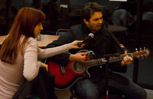 Ricardo Gonzalez performing his own tune and Itzel Garcia assisting him with the mic. Photo by Ashley Costello.