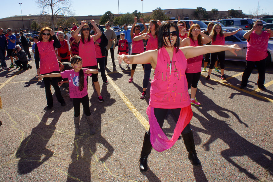 Center, Instructor for Together Strong Zumba Studio, DeLisa Palombi leads her group during the 1 Billion Rising dance at the Santa Fe Place Mall on Feb. 14, 2015. Luke E. Montavon/The Jackalope