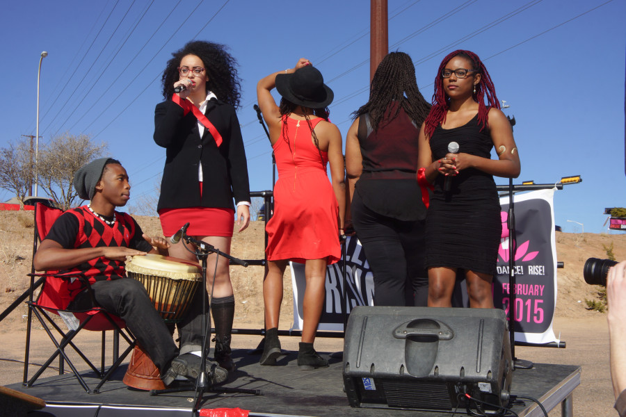 Lefr, Janel Blanco Jean-Bart of 'For Colored Girls' sings to show support and promote their upcoming show during 1 Billion Rising at the Santa Fe Place Mall  on Feb. 14, 2015. Luke E. Montavon/The Jackalope