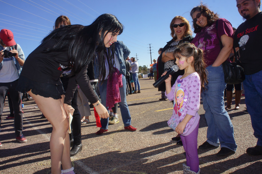 From left, student and organizer Diana Padilla gave supporters like Nataly Bridget Vigil,5, the opportunity to voice their truth during 1 Billion Rising at the Santa Fe Place Mall on Feb. 14, 2015. Luke E. Montavon/The Jackalope