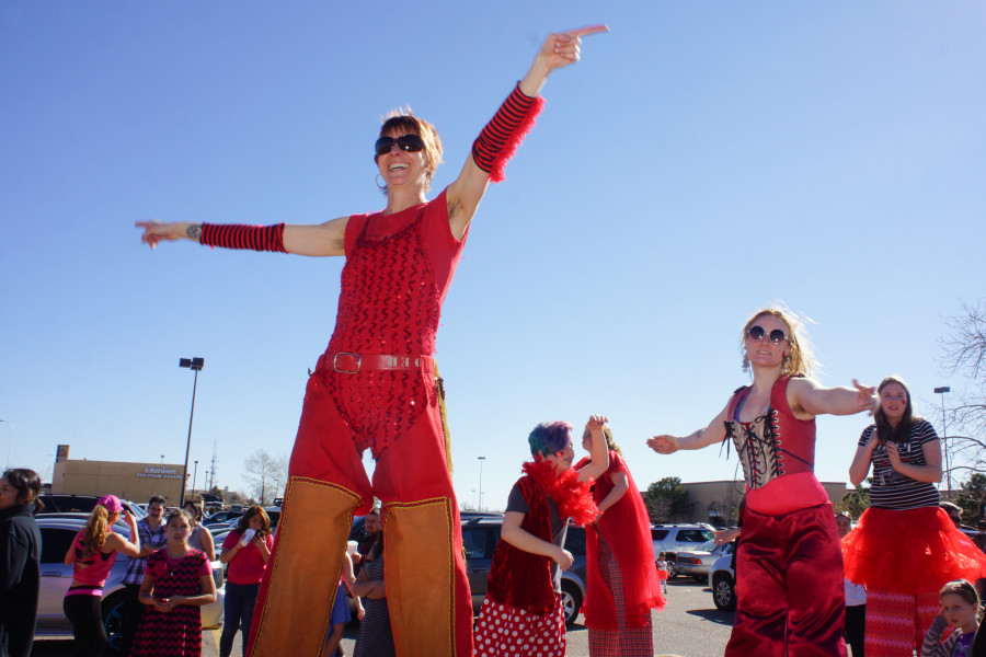 Right, Amy Cristian of Wisfool New Mexico leads other stilted dancers during the 1 Billion Rising dance at the Santa Fe Place Mall  on Feb. 14, 2015. Luke E. Montavon/The Jackalope