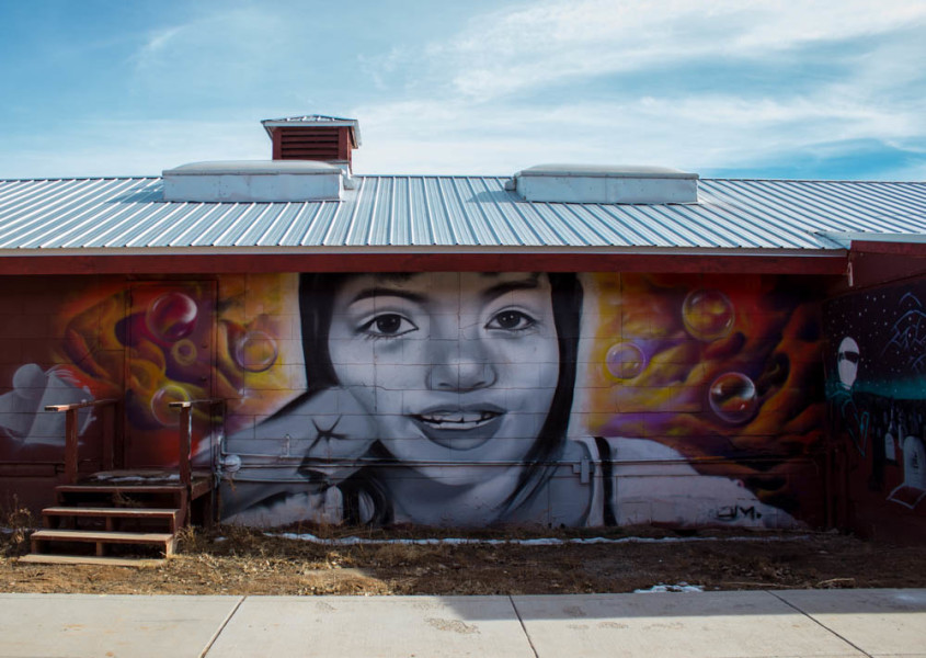 Along the right side of the barracks is a beautiful mural  by former art student Randy Martinez. As a photographer I am inspired by graffiti, and this piece is my favorite that I have come across on campus.  Photo taken by Kyleigh Carter