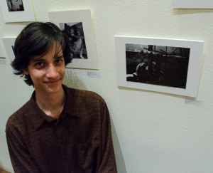 Aram Brown photography student at Monte del Sol with his image A Struggle in the Shadows. Photo by Ashley Costello.