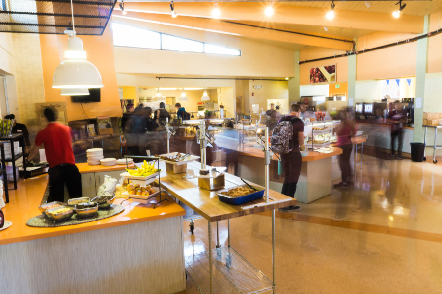 A small secondary lunch hour rush over the course of five seconds at the cafeteria on Mar 25, 2015. Photo by Luke E. Montavon