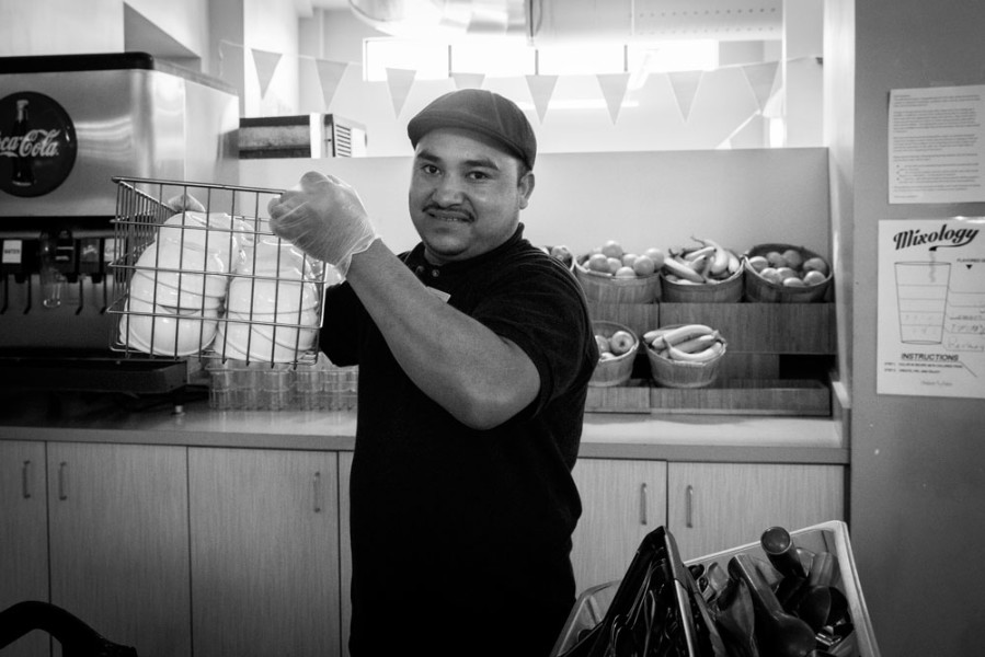 Alonso Hemones, cafeteria employee, setting up for the evening feeding frenzy.  Photo by Jessie Leigh