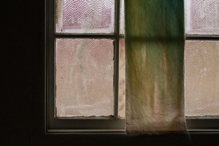 Clay on a windowpane in a bathroom in the barracks. Photo by Ash Haywood
