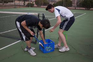 President and Vice President of Tennis Club, Shawn Khounphithack (left), and Brendan Boyle (right), get ready to play a quick match.  Photo by Jessie Leigh